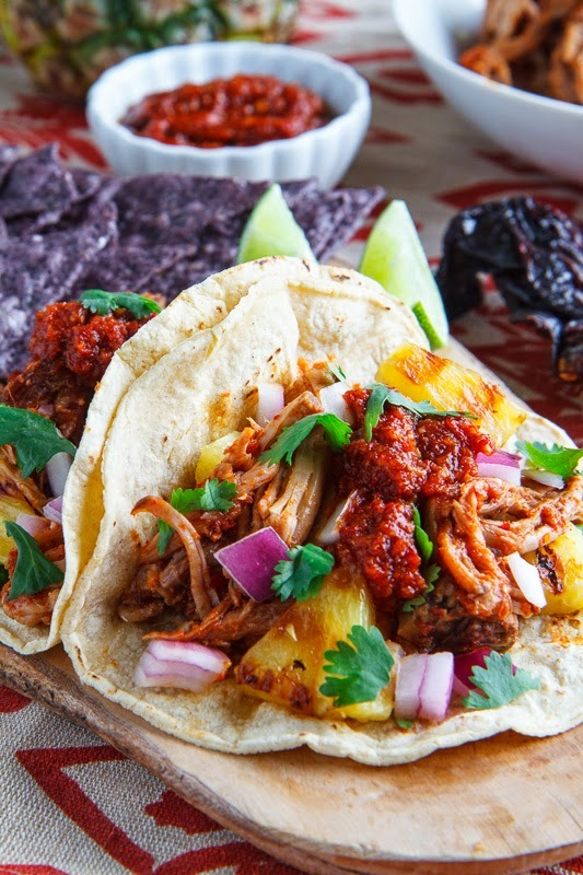 Tacos al pastor with pineapple and salsa roja